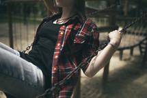 teen girl swinging on a swing