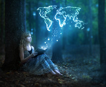 a woman sitting under a tree reading taken away to magical places