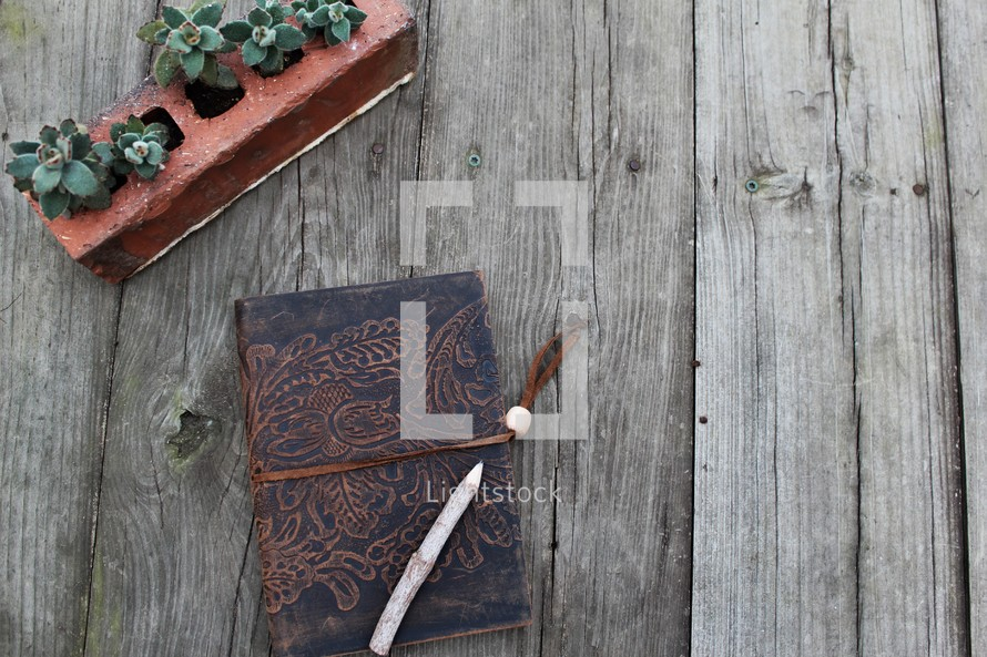 stick pencil on a leather bound Bible