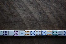 dominoes against a wood background