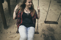 teen girl on a swing
