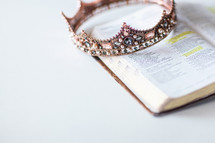 jeweled crown on the pages of a Bible