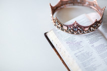 jeweled crown on the pages of an opened Bible