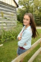 teen girl outdoors in a garden