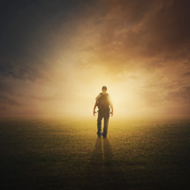 A man walking into the light