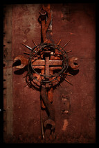 Cross made of rusty tools, nails, barbed wire, saw blades, and found objects. I made this specifically for this purpose.