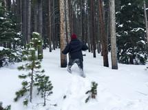 a man walking in deep snow