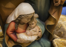 figurines of mother Mary and baby Jesus