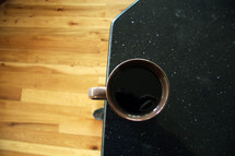 coffee mug at the edge of a table