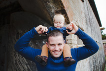 father with infant son on his shoulders