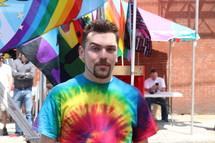 man in a tye dye t-shirt