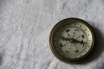 Hand held antique brass compass measuring direction and orientation