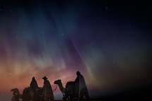 wise men traveling on camels at night