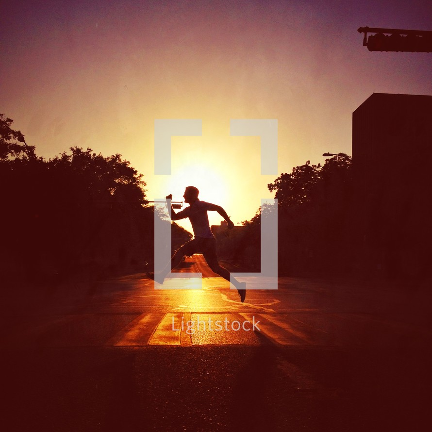 silhouette of a man running at sunset