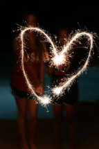 sparklers forming a heart shape