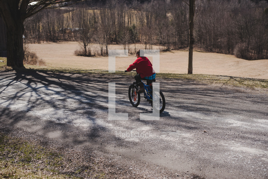 a boy riding a bicycle