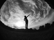 silhouette of a girl balancing