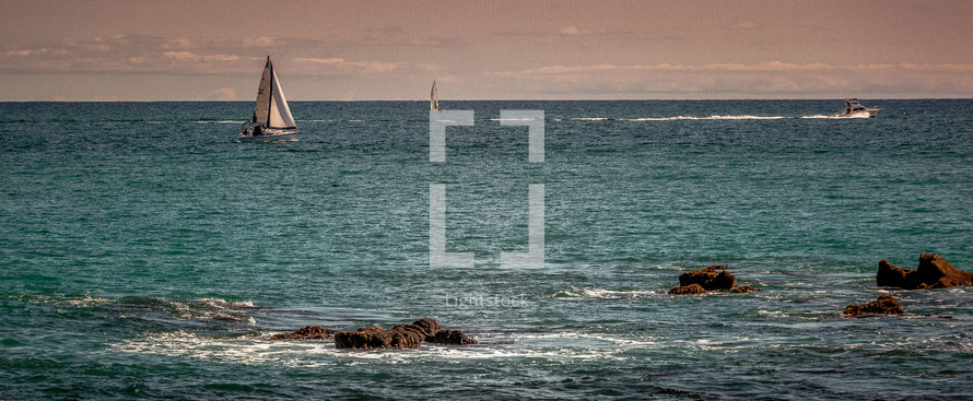 view of a sailboat from a shore