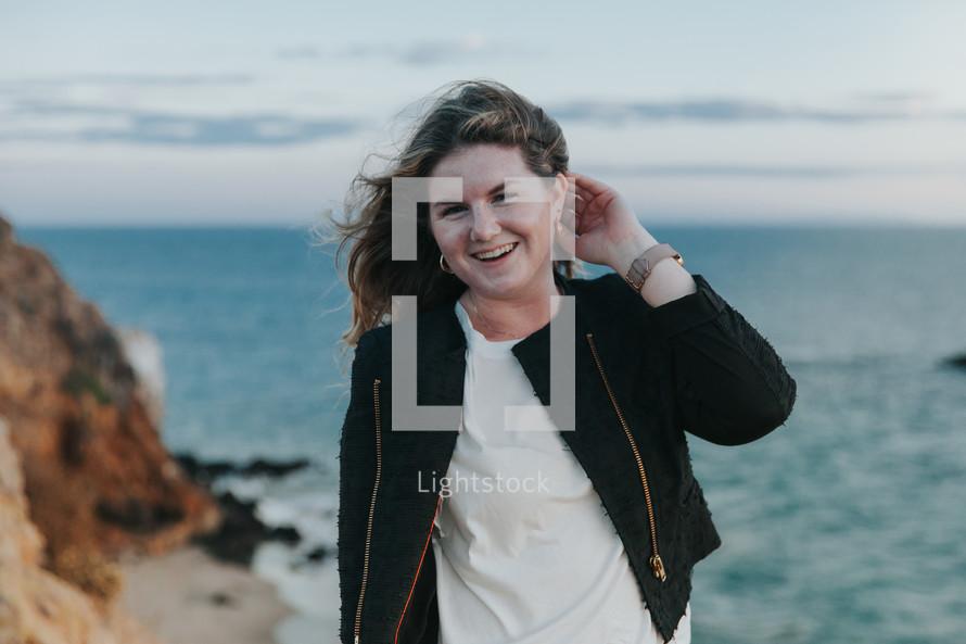 a woman standing on a beach