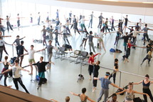 Reflection in a mirror of a ballet class.