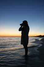 silhouette of a woman taking a picture