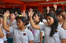 students with raised hands