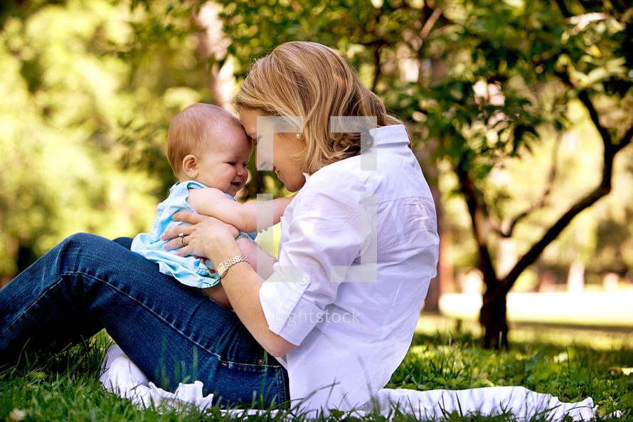 Mother and baby girl in park