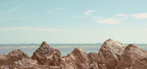 brown rocks along a shore