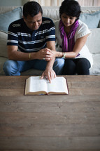 an Indian couple reading a Bible together