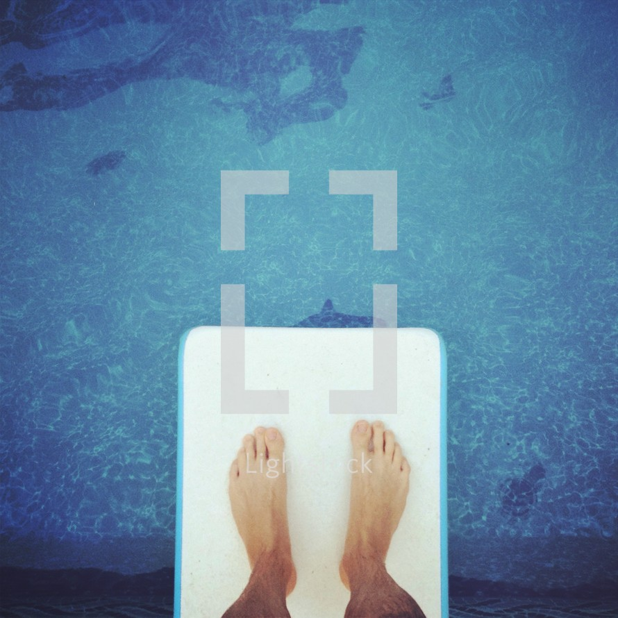 feet on the diving board