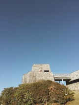 building on a mountain top and blue sky