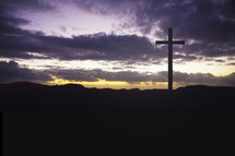 Cross on a hill at daybreak.