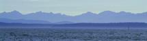 Coastal landscape of purple mountains