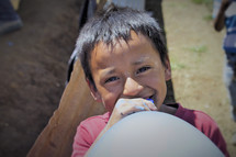face of a little boy with a balloon