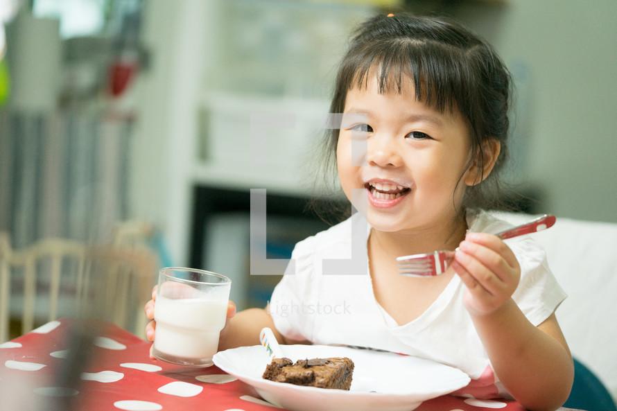 a toddler eating dessert