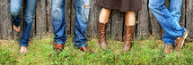 A family wearing blue jeans and cowboy boots