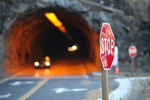 Stop sign by tunnel