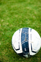 a soccer ball in the grass