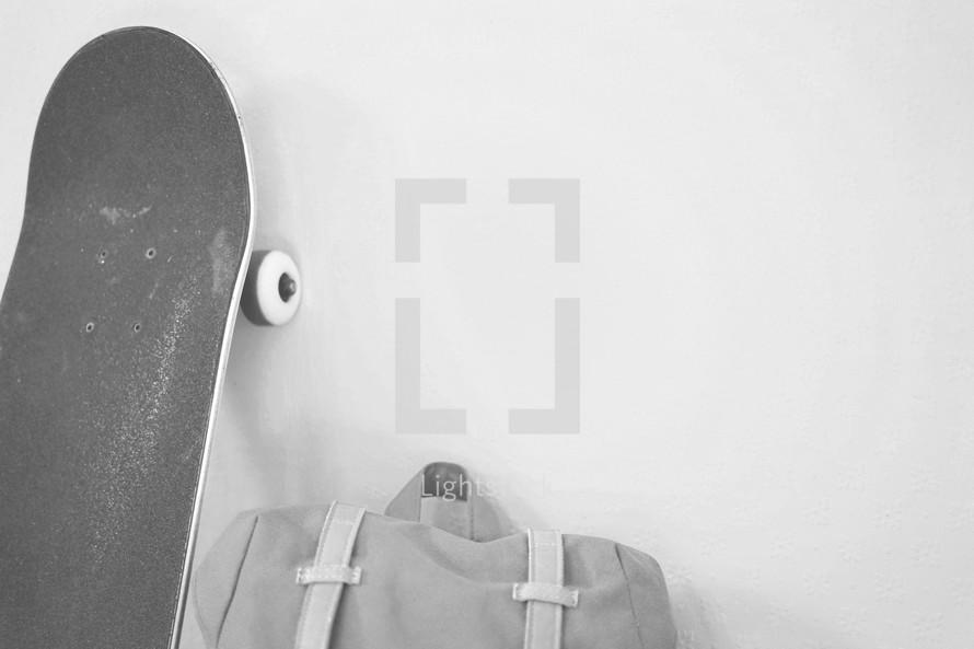 skateboard and book bag