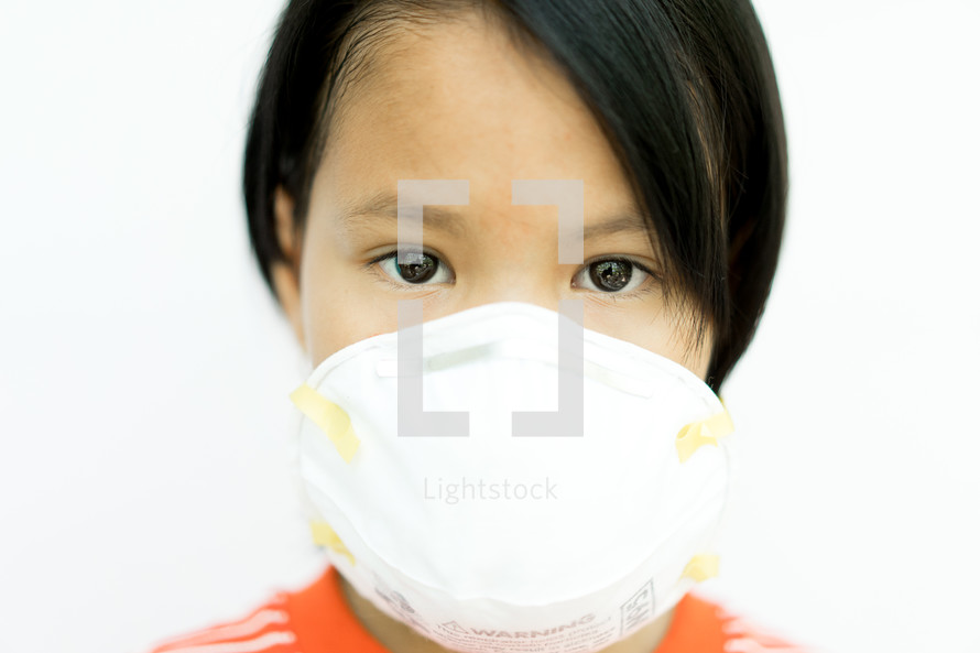 girl child wearing a protective face mask