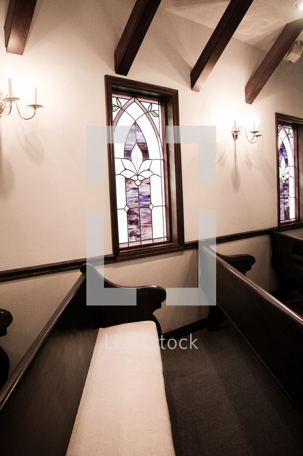 stained glass windows and church pews
