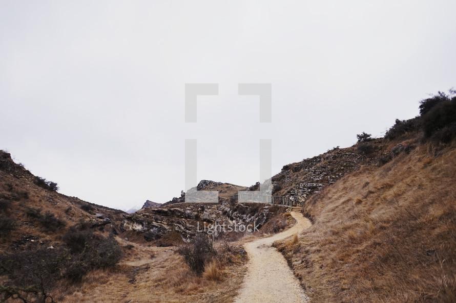dirt path through mountains