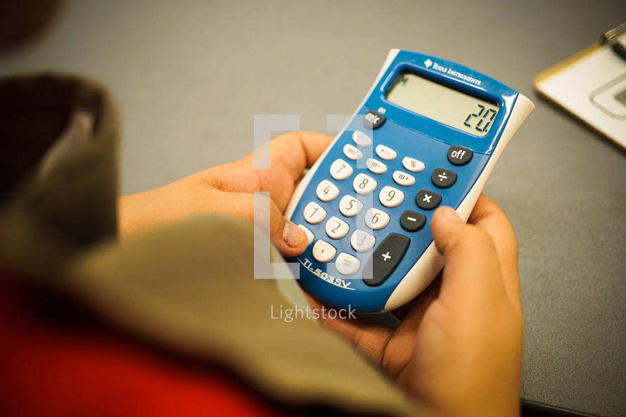 a child with a calculator