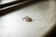 wedding rings in a window sill