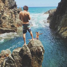cliff diving into the ocean in Hawaii
