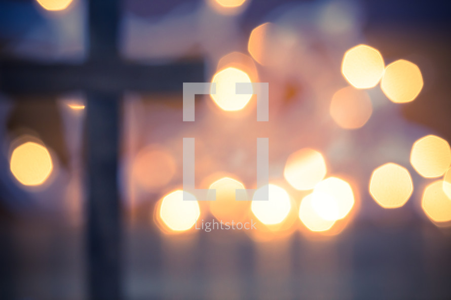 wood cross and bokeh lights