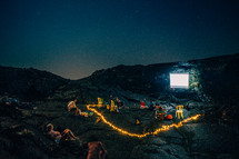 projection screen on a rock at a campsite on a mountain