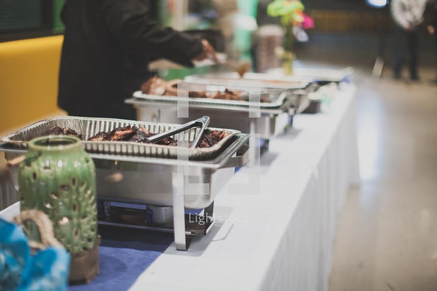 a buffet line of food