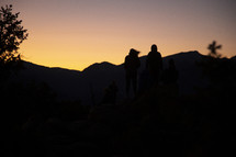 silhouettes of people and mountains