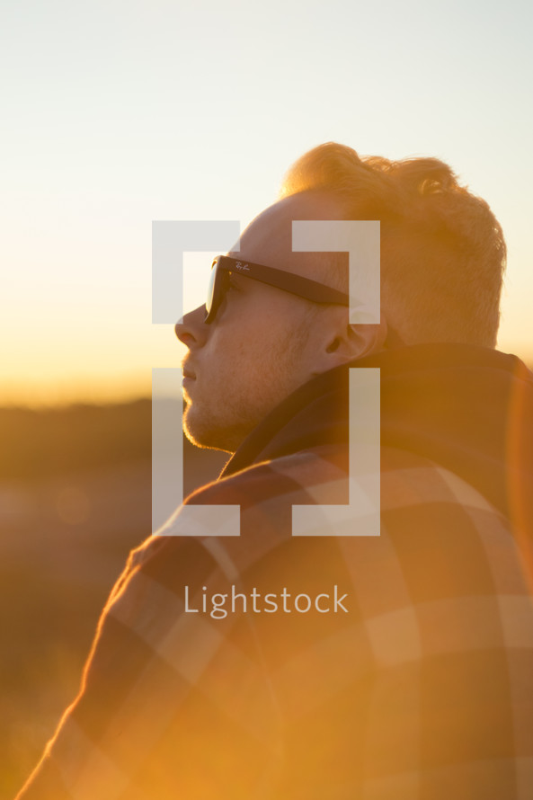 a man looking up in warm sunlight